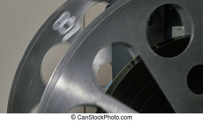 35mm Film Cinema Reels Projecting - A technician rewinds...