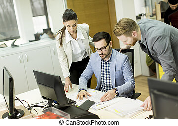 Group of young business people in a meeting at office