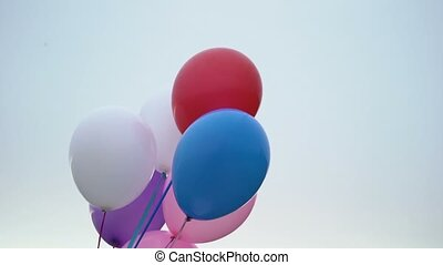 Colorful balloons at the evening outdoors shot