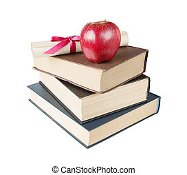 Books, apple and scroll - Concept of education: stack of big...