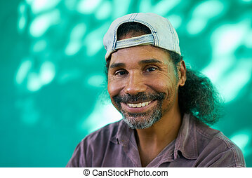 Smiling People Portrait Of Hispanic Man With Goatee Laughing