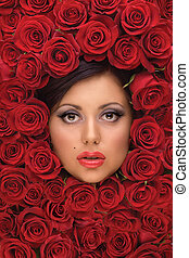 Girl In Red roses - A background with a portrait of a girls...