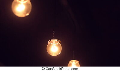 included light bulb in a dark room.