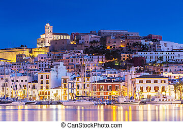 Ibiza Dalt Vila downtown at night with light reflections in...