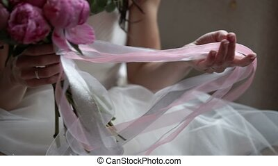 Bridal bouquet in hands at cloudy day