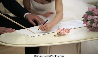 Bride signing document on wedding ceremony closeup