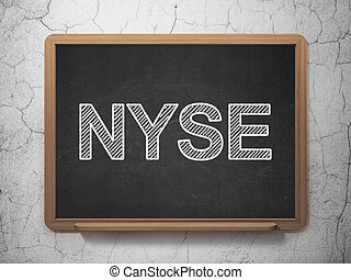 Stock market indexes concept: NYSE on chalkboard background...
