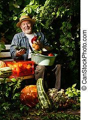 elderly man - Happy senior man with great harvest in the...