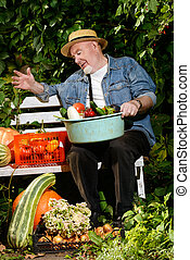 vegetable farming - Happy senior man with great harvest in...