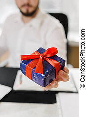 Business man with gifts businessman offering a gift to you -...