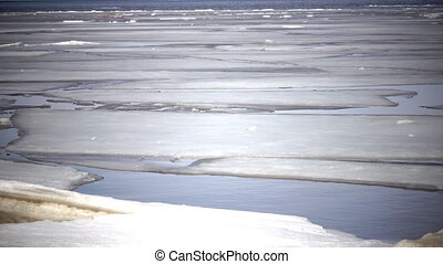 Spring destruction of ice at the seashore