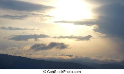Cloud mountain sky sun winter - Telephoto timelapse of sun...