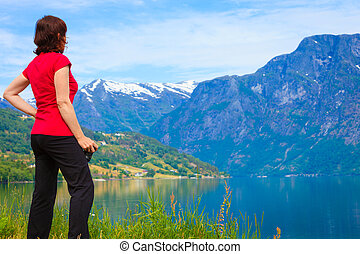 Tourist woman enjoying fjord view in Norway - Tourism...