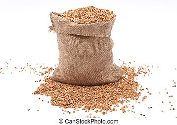 Burlap sack with buckwheat spilling