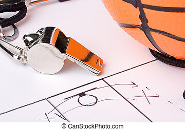 Coach - A silver whistle laying next to an orange basketball...
