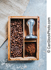 Coffee time - Freshly ground coffee, coffee beans and tamper...