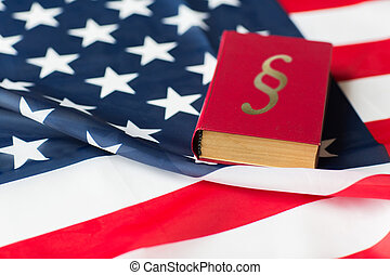 close up of american flag and lawbook - justice, law, civil...