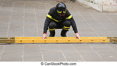 firefighter while assembling the ladder during an emergency...