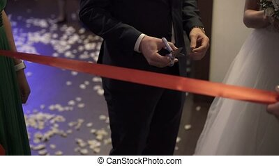 Cutting red ribbon on opening - Cutting red ribbon on...