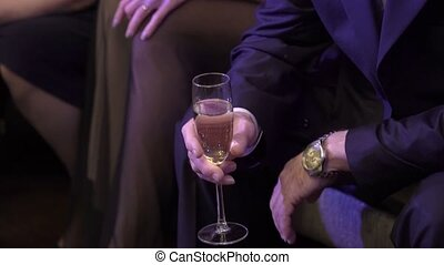 Man sitting with glass of champagne in hand