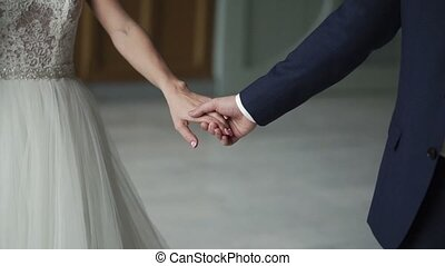 Young lovely wedding couple holding hands slowmotion