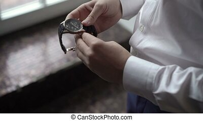 Groom wearing wrist watches closeup