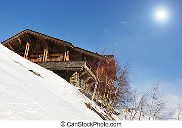 chalet - mountain chalet and snow with blue sky and sun