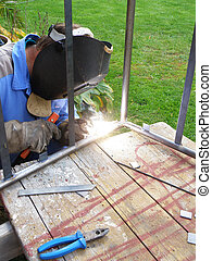 detail of welding - worker site - detail of a man by welding