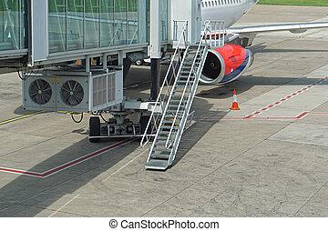 Jet way stairs - Skybridge passenger boarding bridge at...