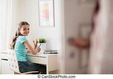 girl with laptop writing to notebook at home - people,...