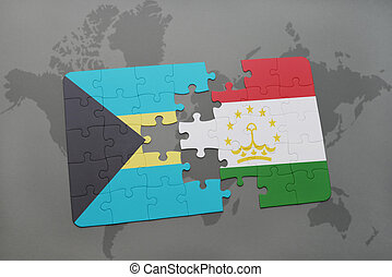 puzzle with the national flag of bahamas and tajikistan on a...