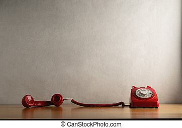 Occupied Retro Red Telephone with Receiver Trailing across...