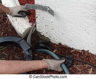 Using Sewer Rod to Remove Blockage - Homeowner uses an...
