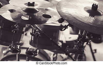 Cymbals of a Drum Set - Closeup view of cymbals in black and...
