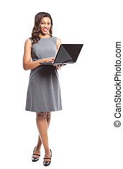 Black businesswoman with laptop - An isolated shot of a...