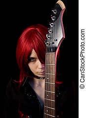 Redhead gothic girl with guitar, isolated on black...