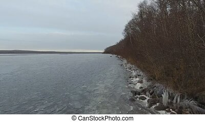 ice lakeshore - video perspective of a lakeshore in its...