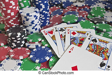 poker chips and four kings