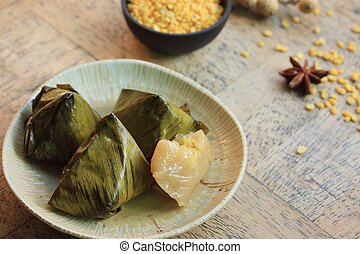 dough wrapped in banana leaves
