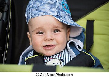 baby boy sitting in the pram - little and very beautiful...