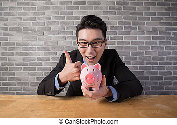 businessman take piggy bank - business man take piggy bank...