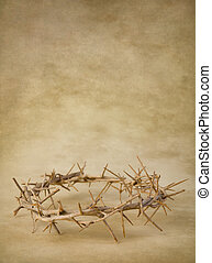 Crown of thorns on grunge wallpaper