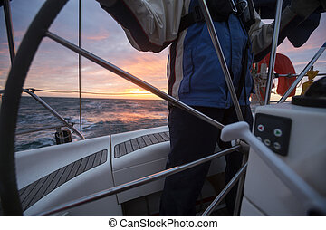 Midsection Of Man Steering Wheel Of Yacht In Sea -...