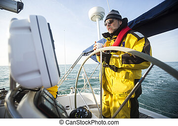 Man Holding Coffee Cup While Standing At Helm Of Sail Boat -...
