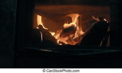 Wood burning in the stove. Fire close up, 4K