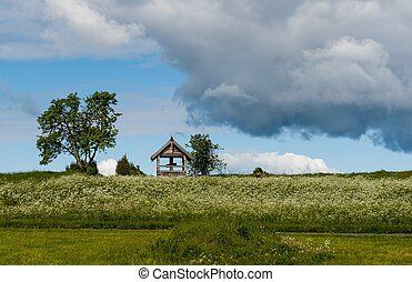 Kizhi landscape with the cross on the hill in Sunny day -...