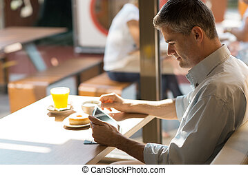 Breakfast at the cafe - Businessman having a delicious...