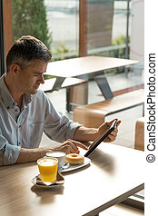 Breakfast at the bar - Businessman having breakfast at the...