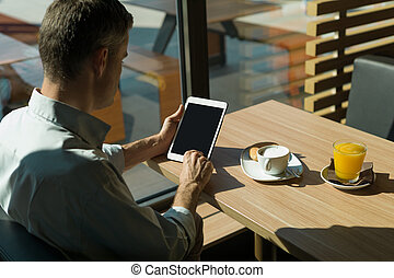 Relaxing breakfast at the bar - Businessman having an...