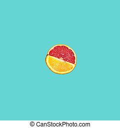 Grapefruit and orange citrus fruit halves on blue...